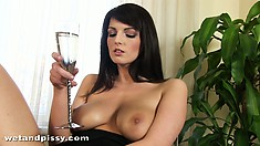 Cynthia sits on the glass table bringing her pussy to orgasm with a sharp dildo