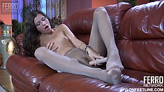 Skinny brunette in pantyhose is on her knees toying her wet hole